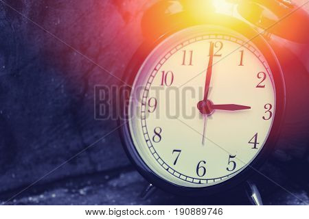 3 O'clock Vintage Clock At Dark Color Tone With Sun Light Memory Time Concept.