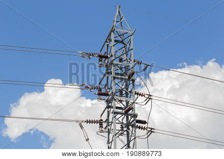 High Voltage Electricity Post Or High-power Tower Against Sky Background