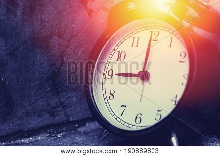 9 O'clock Vintage Clock At Dark Color Tone With Sun Light Memory Time Concept.