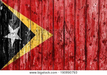 Flag of East Timor painted on wooden frame