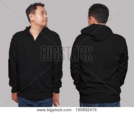Blank sweatshirt mock up front and back view isolated on grey. Asian male model wear plain black hoodie mockup. Hoody design presentation. Jumper for print. Blank clothes sweat shirt sweater