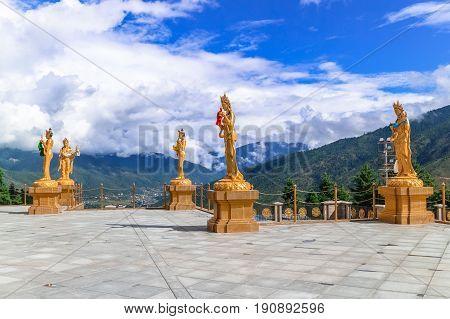 Golden statues of Buddhist female gods at Buddha Dordenma temple Thimphu Bhutan South Asia