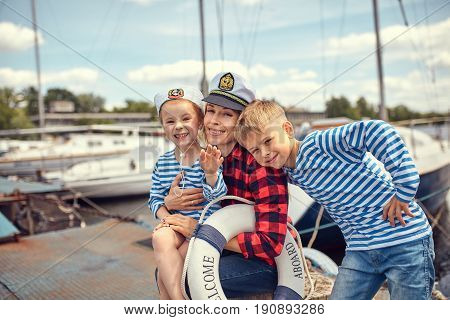 Family on the pier against the background of yachts.