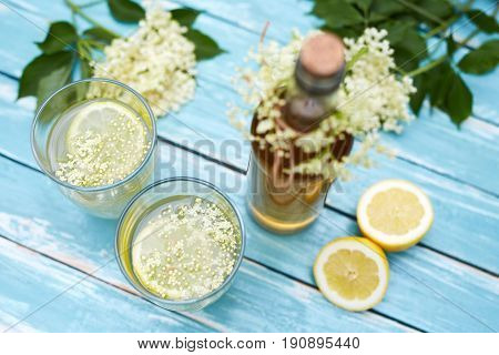 Two Glasses Of Elderflower Lemonade And Bottle