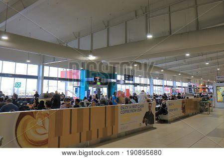 GOLD COAST AUSTRALIA - MAY 30, 2017: Unidentified people travel at Gold Coast International airport.