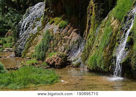 Waterfalls and river rocks in Baume-Les-Messieurs valley