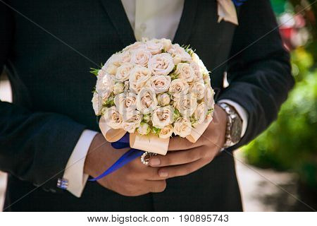 bridal bouquet in hands, wedding bouquet in hands of the groom, groom morning, businessman, wedding, man's fashion, man's style, Festive bouquet of the bride
