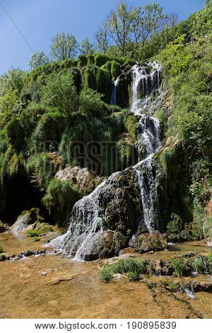 A waterfalls landscape in the Baume-Les-Messieurs valley.
