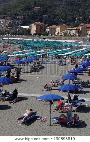 LEVANTO Italy June 2 2017 : The beach of Levanto. Levanto in the Italian region Liguria lies on the coast at the end of a valley thickly wooded with olive and pine trees and a part of its territory is included in the Cinque Terre National Park.
