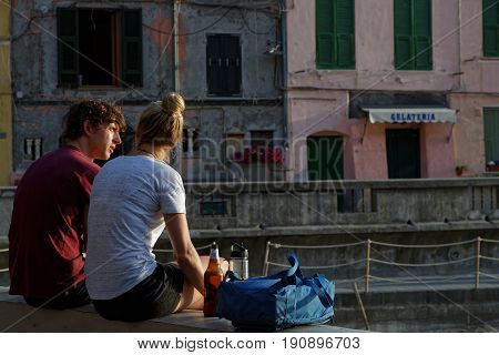 Vernazza, Italy, June 4, 2017 : A Young Couple Admires The Village In The Cinque Terre National Park