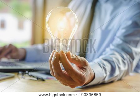 business man holding light bulb concept idea with innovation and creativity