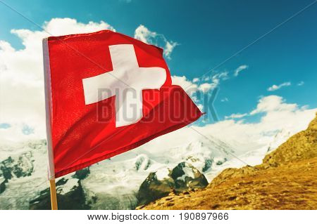 Close up image of swiss flag in beautiful mountains landscape