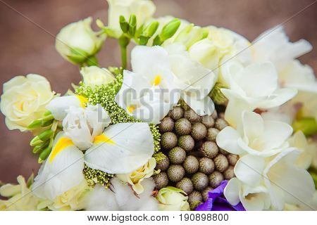 Wedding bouquet. Bride's flowers. Festive bouquet of the bride, rings