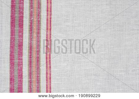 Natural background from rough Ukrainian linen cloth.