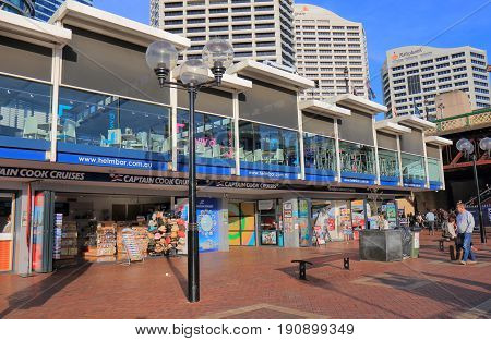 SYDNEY AUSTRALIA - MAY 30, 2017: Unidentified people visit Darling Harbour cruise ticket office.