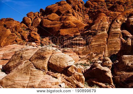 Red Rock Canyon NV - October 6 2016: rock face at Red Rock Canyon National Conservation Area. The national park is a popular tourist destination near Las Vegas Nevada.