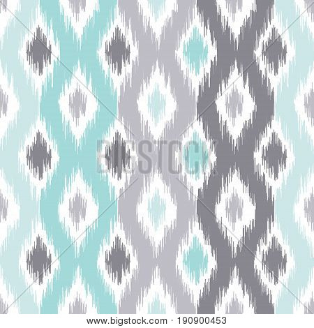 Seamless geometric pattern based on ikat fabric style. Vector illustration. Carpet rug texture vector imitation. Turquoise mint and grey ogee pattern.
