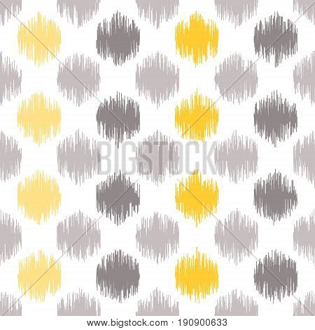 Seamless geometric pattern based on ikat fabric style. Vector illustration. Carpet rug texture vector imitation. Yellow and grey spots pattern.