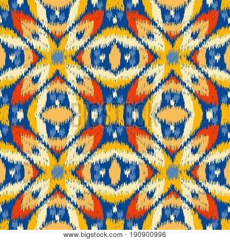 Seamless geometric pattern based on ikat fabric style. Vector illustration. Carpet rug texture vector imitation. Colorful rug pattern in yellow red blue and orange.