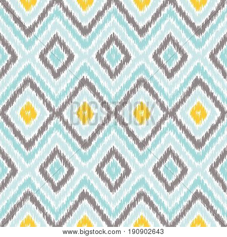 Seamless geometric pattern based on ikat fabric style. Vector illustration. Carpet rug texture vector imitation. Yellow turquoise mint and gray chevron pattern.