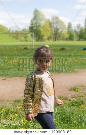 Portrait of a little girl on a spring day