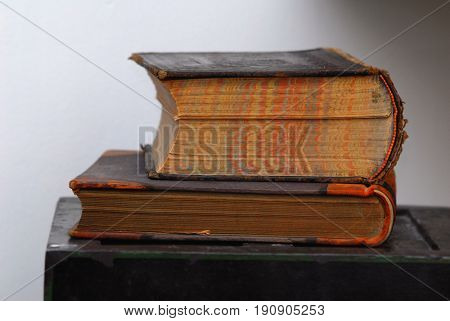 Close-up image of old books with soft background