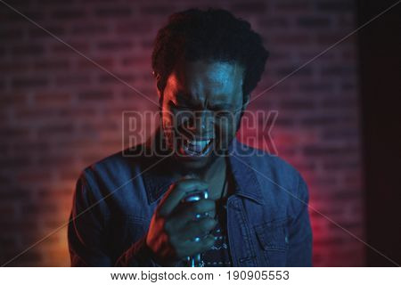 Close up of male singer performing in