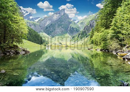 Tranquil scene of seealpsee lake reflecting the mountain of Alpstein Appenzell Switzerland