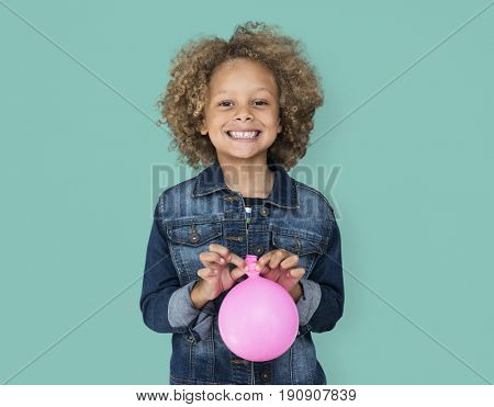 Portrait of a Little African Descent Boy with a Balloon Isolated