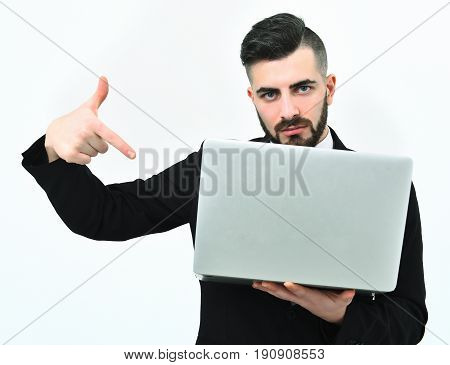 Strict And Concentrated Ceo With Beard Pointing At Laptop