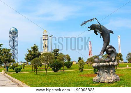 Batumi, Georgia - May 2, 2017: City panoramic landscape with Chacha tower, ferris wheel and dolphin statue in Batumi, Georgia summer Black sea resort