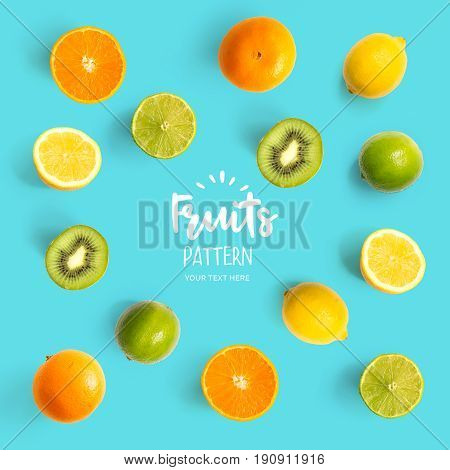 Pattern with kiwi, lime, lemon and orange. Tropical abstract background. Kiwi, lemon and orange on the turquoise background.