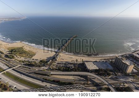 Aerial view of the Ventura pier and freeway along the pacific coast in Southern California.