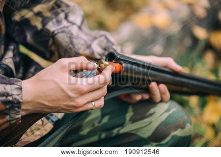 Classic vertical two barrels hunting rifle in hunters hand