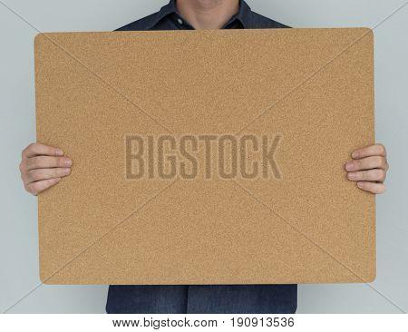 Man Holding Cork Board Copy Space Concept