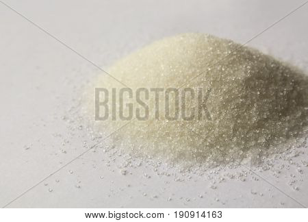 Heap of granulated rafinated sugar. refined sugar sand background.