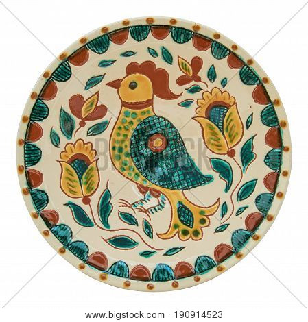 Covered with glaze ceramic plate handmade. Drawing on a plate - the cock. Painting in the technique Kosovo ceramics - it really authentic Ukrainian technique of painting on clay. Isolated on a white background