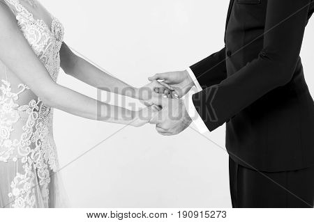 ballrom dance couple in love holding hands isolated on white bachground. sensual professional dancers dancing walz tango slowfox and quickstep black and white