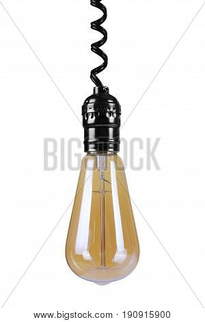 Incandescent light bulb hangs down on top on a white background. It is isolated the worker of paths is present.