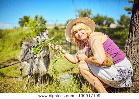 Funny picture a beautiful young girl farmer with in Hat