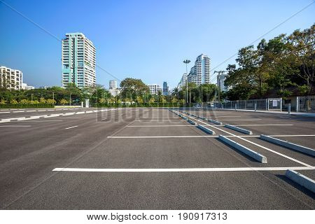 Empty parking lot at city centre with blue sky