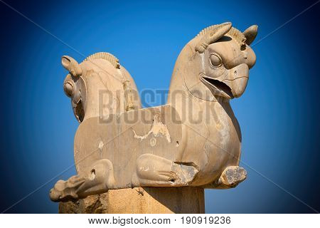 Twin Homa or Huma bird figures used as decorative capital statuary of a column in Persepolis Takhte Jamshid of Iran.