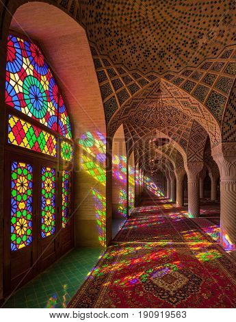 SHIRAZ, IRAN - SEPTEMBER 18, 2014: Interior of ornamental Nasir-Ol-Molk Mosque with colorful stained glass windows. It is also called Pink Mosque and was built between 1876 to 1888 during Qajar rule.