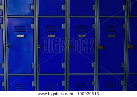 Close up of closed blue lockers at school