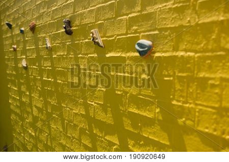 Full frame shot of yellow climbing wall at school