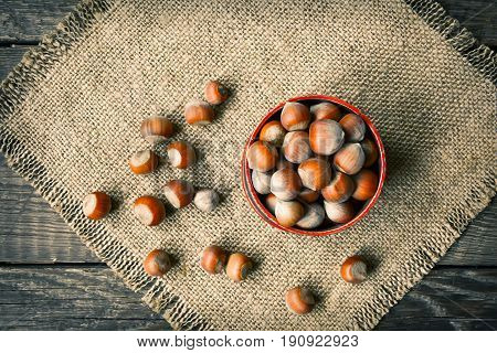 Hazelnuts on a wooden background, close up