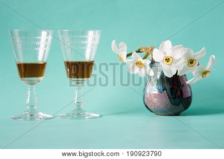 Romantic Date. Cognac Or Brandy. White Daffodils In Vintage Vase.
