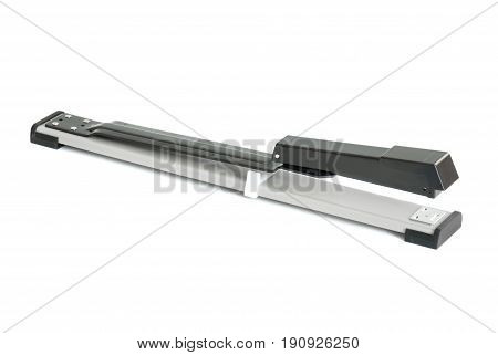 long metal stapler on a white background
