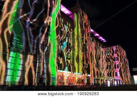 SYDNEY AUSTRALIA - MAY 31, 2017: Unidentified people visit Vivid Sydney illumination at Museum of Contemporary Art in Circular Quay.