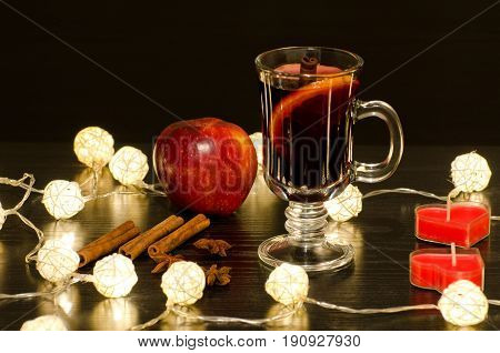 Mug Of Mulled Wine With Spices, Candles In The Shape Of A Heart, Cinnamon Sticks, Star Anise. Illumi